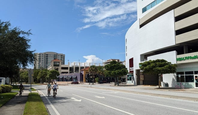 Bicyclists on Ringling Boulevard. The city of Sarasota will add a bike lane to the road in each direction between Lime and Pineapple avenues, along with other safety elements.