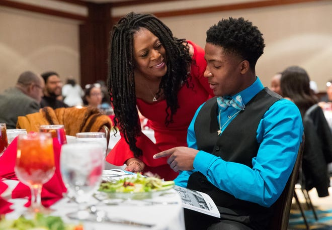 Teresa Haley, president of Springfield's NAACP branch, reviews the program with Pharrell Jackson, the Master of Ceremonies for the 99th Annual Lincoln-Douglass Freedom Fund Banquet at the Crowne Plaza Sunday, Feb. 9, 2020.