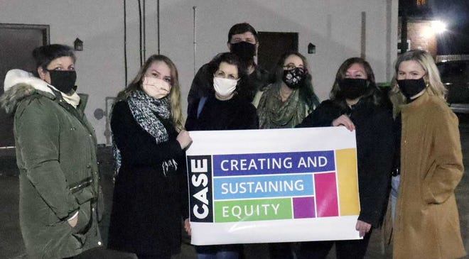 CASE - Creating and Sustaining Equity's founding members include Caitlin Trombley, her husband Robert and five young professional women in town - Kelly Rogers, Bailey Evans, Niki Potter, JoAnna Wishon, and Heather Guthrie.