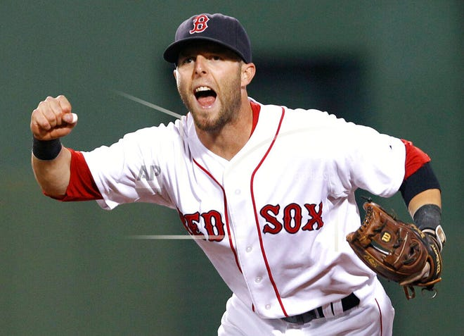 In this Aug. 16, 2011, file photo, Boston Red Sox second baseman Dustin Pedroia celebrates the completion of a triple play against the Tampa Bay Rays during the fourth inning of the second baseball game of a doubleheader in Boston. Pedroia, who was the 2007 Rookie of the Year and the AL MVP in his second season, retired Monday, Feb. 1, 2021.