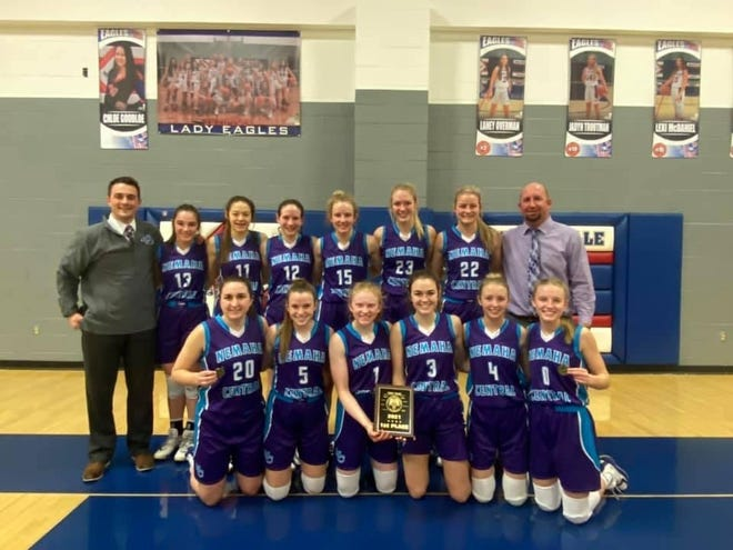 Nemaha Central's girls pose with the Wellsville Top Gun Invitational title after beating Louisburg 52-48 in the title game. The Thunder are 13-0 after winning the tourney and have won 37 straight games dating back to last season's 24-0 record.