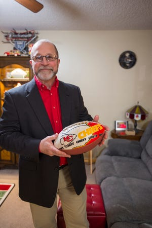 Behind the sofa he sits in every fall Sunday to watch the Kansas City Chiefs, Curt Herrman keeps the first item he ever obtained for his collection — a football he got after the team's first Super Bowl win in 1970.