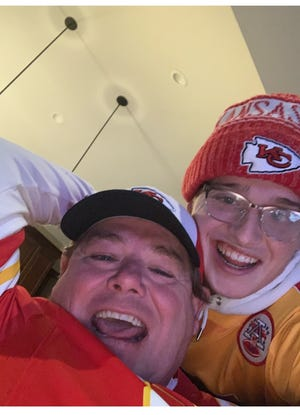 Roger Ward, left, and Jace Ward smile for a photo while wearing Kansas City Chiefs gear. The father and son will attend the Super Bowl this weekend.