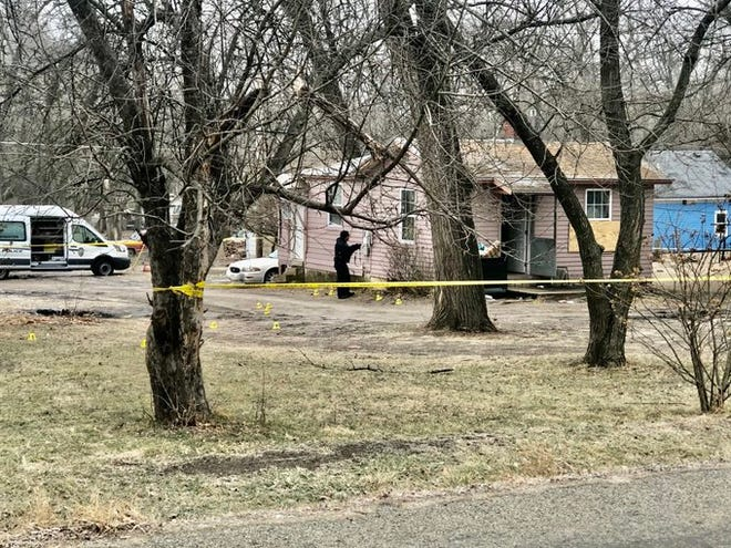 Yellow Crime Scene tape was up and various cones could be seen marking places where shell casings were found after numerous gunshots were fired about 4 a.m. Tuesday into a house at 804 S.E. Sherman Ave., critically wounding a 1-year-old baby.
