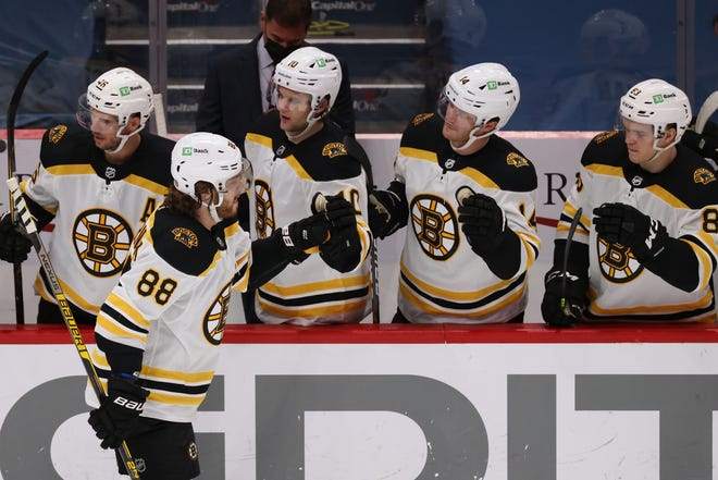 Bruins right wing David Pastrnak (front) celebrates with teammates after scoring in the second period, his first of two goals Monday in Boston's comeback win over Washington.