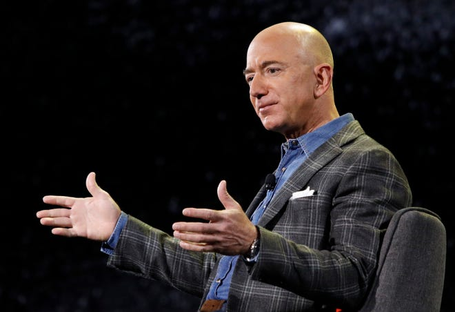 In this 2019 file photo, Amazon CEO Jeff Bezos speaks at the Amazon re:MARS convention in Las Vegas.