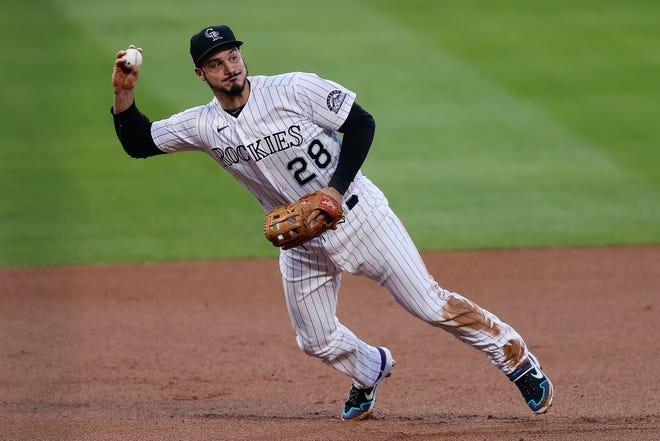 Third baseman Nolan Arenado is heading to the Cardinals.