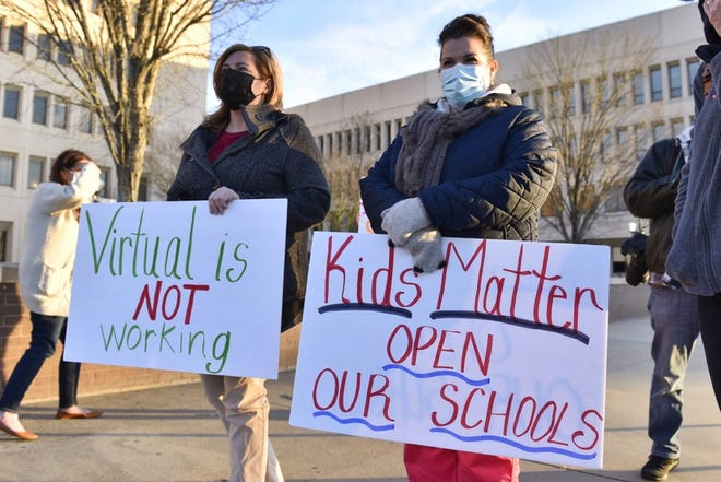 Mothers of students in Cumberland County Schools attend a rally Tuesday, Feb. 2, 2021, calling for Cumberland County Schools to reopen.