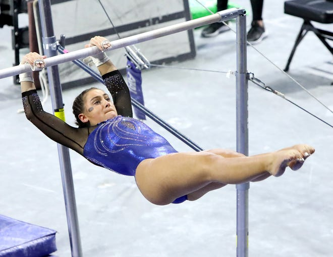 Florida gymnast Gabrielle Gallentine performs on the bars against Georgia at Exactech Arena on Jan. 15. The Gators beat the Bulldogs 197.250 to 196.075.