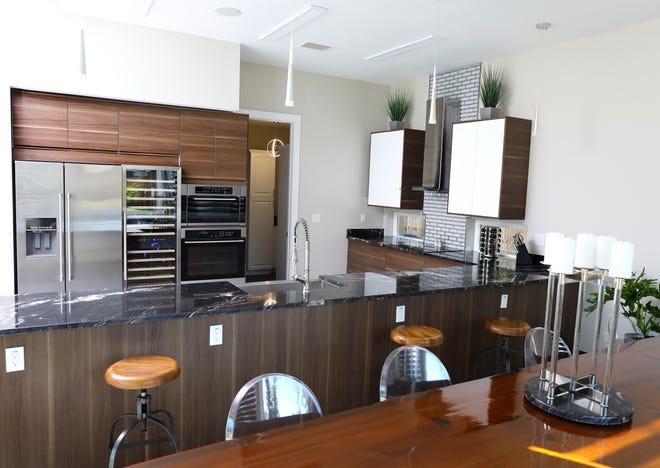 The kitchen carries through the modern, European flair without stark minimalism.