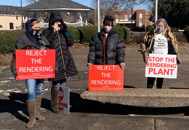Opponents of a proposed rendering plant in Gadsden braved the cold and wind on Feb. 2 outside City Hall, as the Gadsden City Council discussed the issue inside.