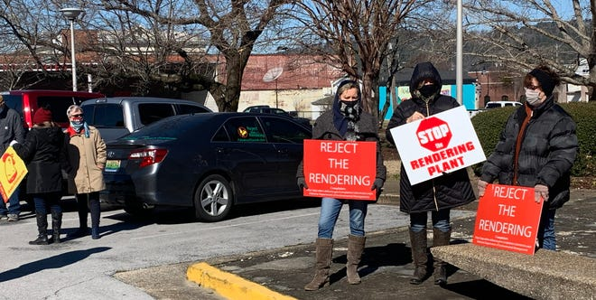 Opponents of a proposed rendering plant in Gadsden braved the cold and wind on Tuesday outside City Hall, as the Gadsden City Council discussed the issue inside.