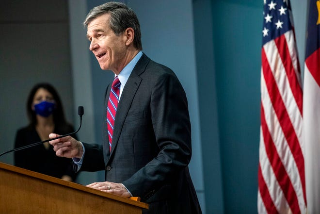 Gov. Roy Cooper speaks during a briefing on North Carolina's coronavirus pandemic response Wednesday, Jan. 27, 2021 at the NC Emergency Operations Center in Raleigh.(Travis Long/The News & Observer via AP)