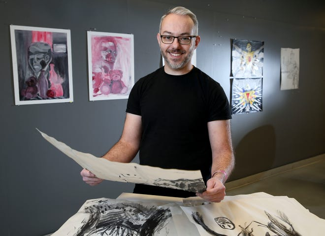 Carson Grubaugh poses in an art studio at Shelton State where he is an instructor Tuesday, February 2, 2021. [Staff Photo/Gary Cosby Jr.]