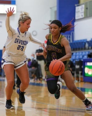 Reynoldsburg's Imarianah Russell drives against Hilliard Davidson's Brianna O'Connor earlier this season. Russell scored her 1,000th career point Feb. 2 against Gahanna and was averaging 21.5 points through 14 games for the Raiders, who are seeded third for the Division I district tournament.