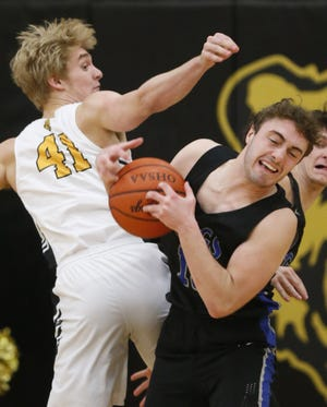 Bradley's Peyton Murphy grabs a rebound against Upper Arlington's John Mollmann earlier this season. The Jaguars were 12-2 overall and 6-1 in the OCC-Central before facing Olentangy Liberty on Feb. 5.