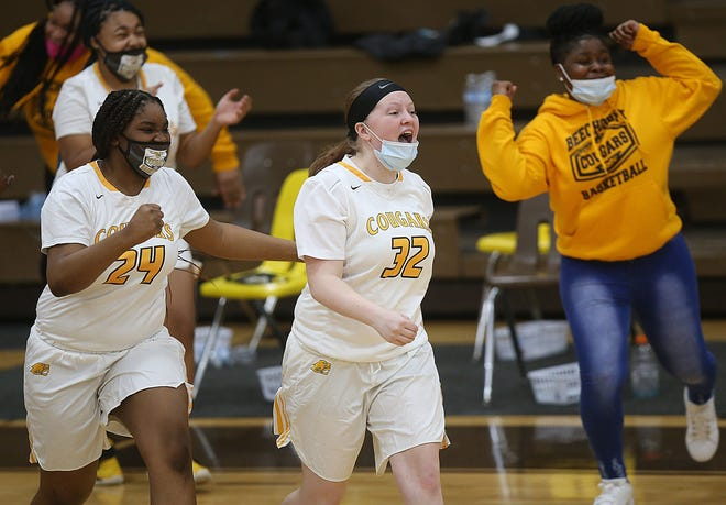 Beechcroft's Stella Emeran-Simon and Danielle Nunley run onto the court to celebrate the Cougars' 49-48 win over visiting Northland on Jan. 27. It was the Cougars' first win over the Vikings since Jan. 30, 2004.