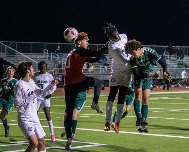 Waxahachie's Jesse Garcia (11, right) nods home the game-winning goal in the final minute against Mansfield Lake Ridge during Friday night's home match. The Indians improved to 2-0 in district play with a 2-1 victory.
