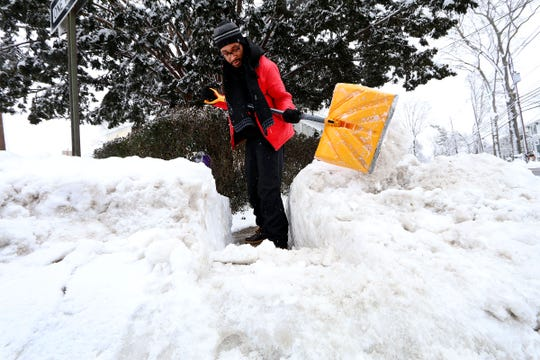 Kevin Jean-Louis clears the snow from the sidewalk outside his Church Street home in Allentown Tuesday morning, February 2, 2021.