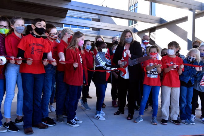 Taylor Elementary students and Principal Keri Thornburg cut the ribbon Tuesday, celebrating the opening of the newest Abilene ISD campus in northeast Abilene. Students and staff were joined by the Abilene Chamber of Commerce Redcoats and members of the Abilene Independent School District's trustees for the event.