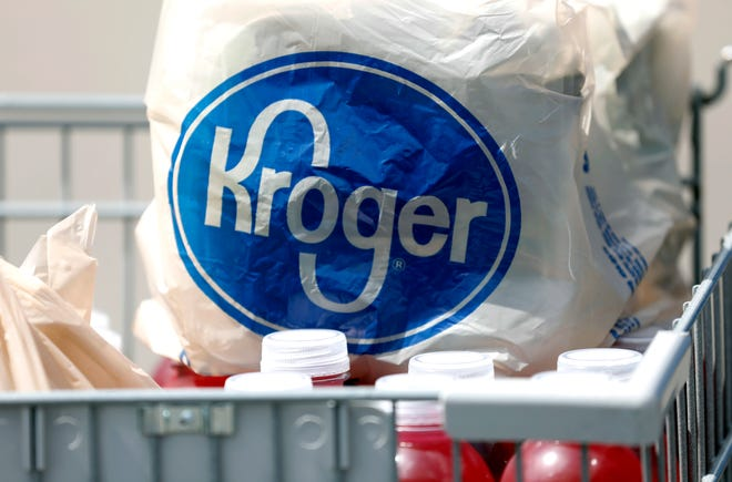 FILE - Kroger Co. will close two supermarkets in Southern California in response to a local ordinance requiring extra pay for certain grocery employees working during the coronavirus pandemic. The decision announced by the company Monday, Feb. 1, 2021, follows a unanimous vote last month by the Long Beach City Council mandating a 120-day increase of $4 an hour for employees of supermarkets with at least 300 employees nationwide and more than 15 in Long Beach.