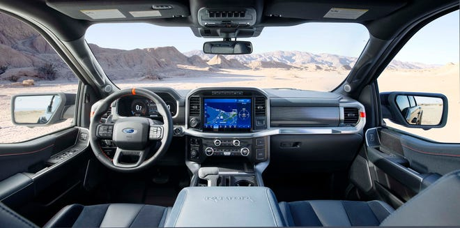 The big cabin in the 2021 Ford F-150 Raptor features a retractable gear shift so the console can be turned into a desktop.