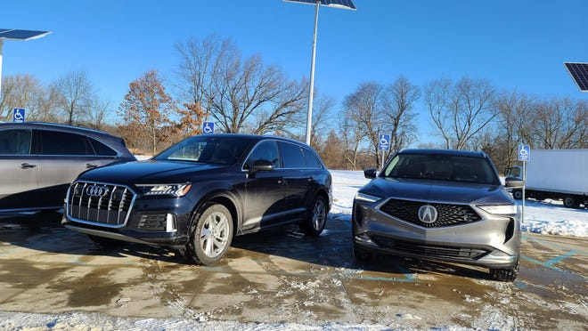 The 2022 Acura MDX takes on the Audi Q7, left, as a ute with nimble handling. A double wishbone front suspension helps.