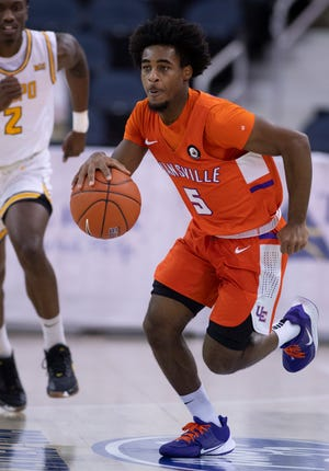 University of EvansvilleÕs Shamar Givance (5) drives up-court against Valparaiso during their game at the Ford Center Monday night, Feb. 1, 2021.