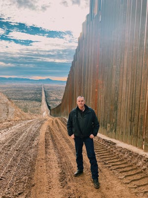 Montana Representative Matt Rosendale stands at a portion of the completed border wall on the Arizona/Mexico border.