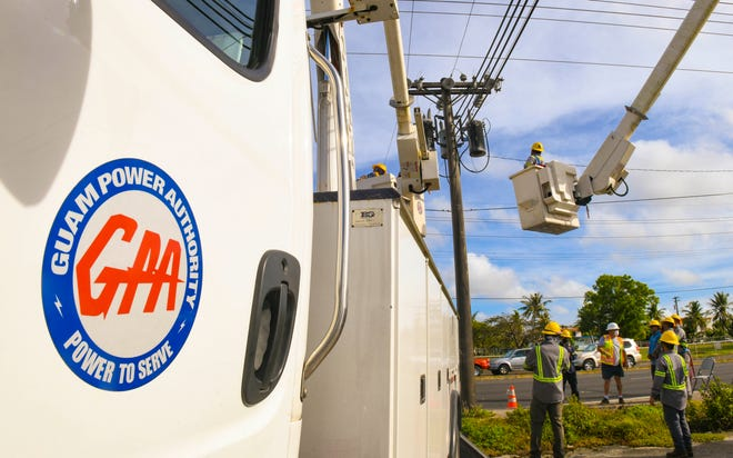 Guam Power Authority employees work on overhead transmission line along Marine Corps Drive, near the Dededo Mall, on Tuesday, Feb. 2, 2021.