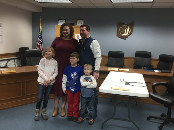 New Lexington council member Katie Getz poses with husband Tyler and children Quinn, Cooper and Xavier at Monday night's meeting.
