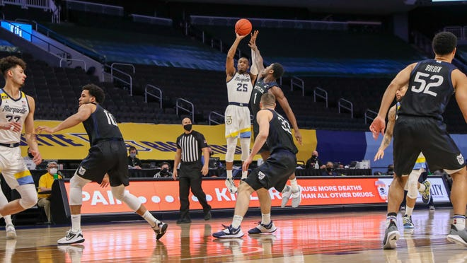 Marquette guard Koby McEwen fires a jumper in the first half against Butler on Tuesday.