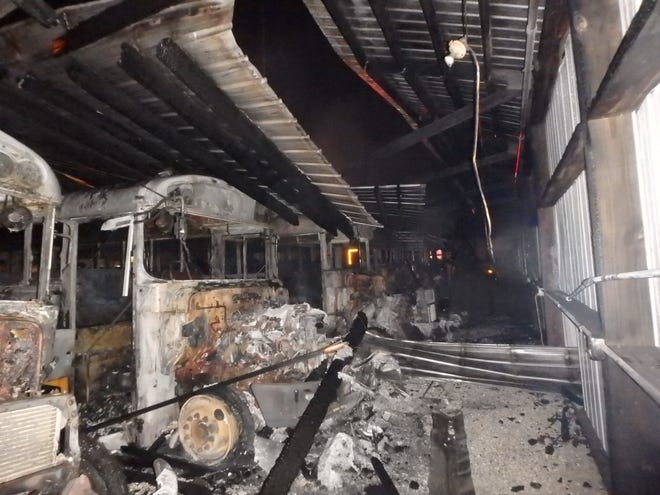 Six school buses and a shed at Thomas Bus Co. in the Town of Burlington were damaged in a fire Tuesday morning.