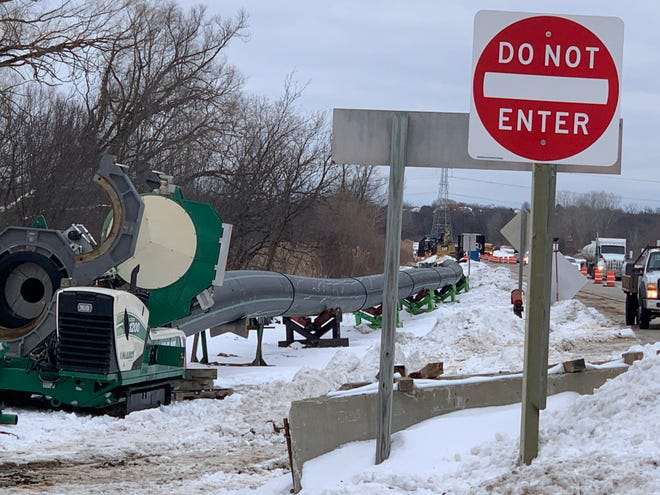 Crews from contractor S.J. Louis Construction work on the installation of a pipeline on Les Paul Parkway just west of East Avenue on Feb. 2. The construction area was among those that the village of Waukesha says needed a permit beyond an existing intergovernmental agreement between the two municipalities. The village has since dropped its lawsuit against the city of Waukesha.