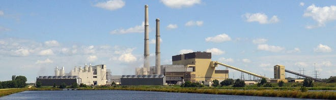 Alliant Energy says it plans to retire the coal-fired Columbia Energy Center near Portage by 2024.