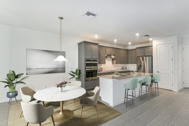 Hamilton Place by Toll Brothers is offering a 1,905 square-foot, move-in ready Seagrape townhome featuring three bedrooms, three and one-half baths, and a spacious loft.