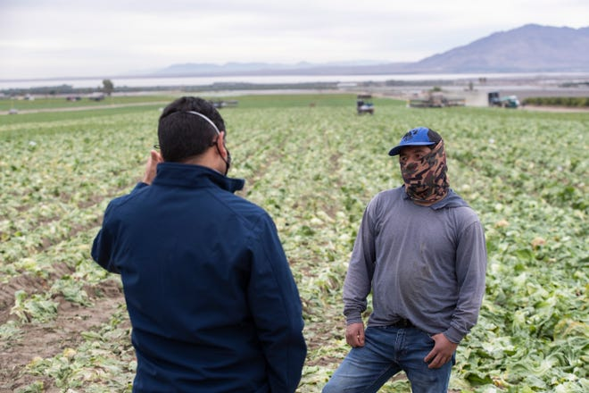 U.S. Congressman Dr. Raul Ruiz speaks to Ruben Hernandez Perez, a farmworker from in Mecca about getting inoculated with the COVID-19 vaccine during a visit to the eastern Coachella Valley on February 1, 2021. The Congressman has advocated for farmworkers to be vaccinated as a priority.
