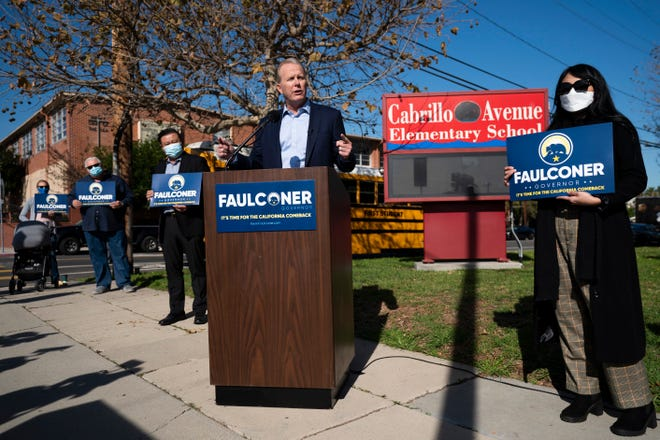 Former San Diego Mayor Kevin Faulconer, center, speaks during a news conference in Tuesday, Feb. 2, 2021, in the San Pedro section of Los Angeles. Faulconer announced Monday he is entering the race for California governor, the first major Republican to formally step into the contest while a potential recall election aimed at Democratic Gov. Gavin Newsom moves closer to qualifying for the ballot this year.