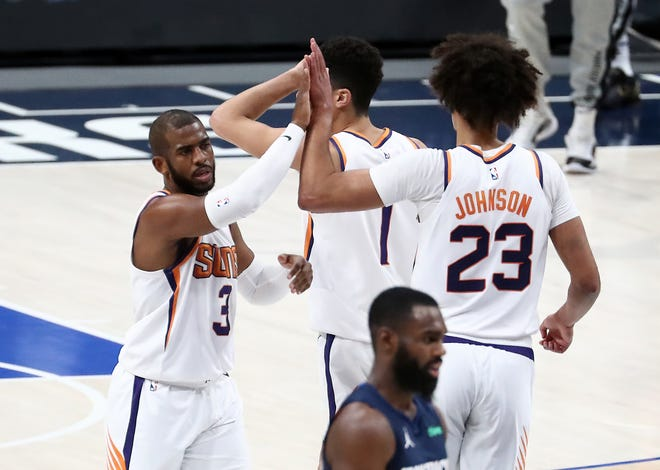 Feb 1, 2021; Dallas, Texas, USA; Phoenix Suns guard Chris Paul (3) celebrates with forward Cameron Johnson (23) during the first half against the Dallas Mavericks at American Airlines Center. Mandatory Credit: Kevin Jairaj-USA TODAY Sports