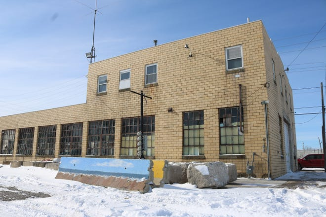 """The property at 317 W. Perry St. is now in the hands of the Greater Port Clinton Area Arts Council after the 50-year lease with the city was signed this week. The GPCAAC plans to transform it into """"The Art Garage."""""""