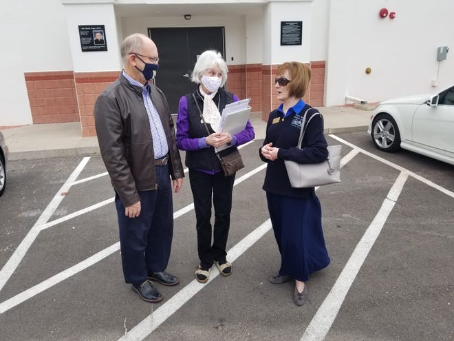 Tim Martin (left) and Nancy Norbeck (center), both tax preparers, meet with Carole Drake (right), Pastoral Assistant and Community Outreach for Saint George Catholic Church, to discuss how taxpayers will drop off their forms at Kuzy Hall on the west side of the Saint George Catholic Church.