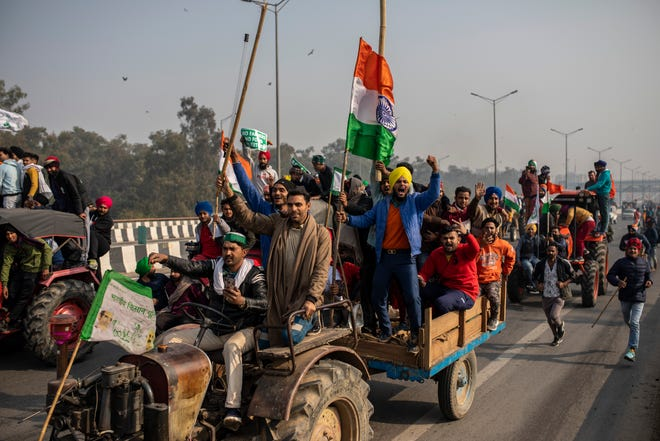 Protesting farmers ride tractors and shout slogans as they march to the capital breaking police barricades during India's Republic Day celebrations in New Delhi, India. Images of thousands of farmers streaming into India's capital to decry potentially devastating changes in agricultural policy can seem a world away, but the protests in New Delhi raise issues that resonate in the United States and have led to dramatic change in rural America.