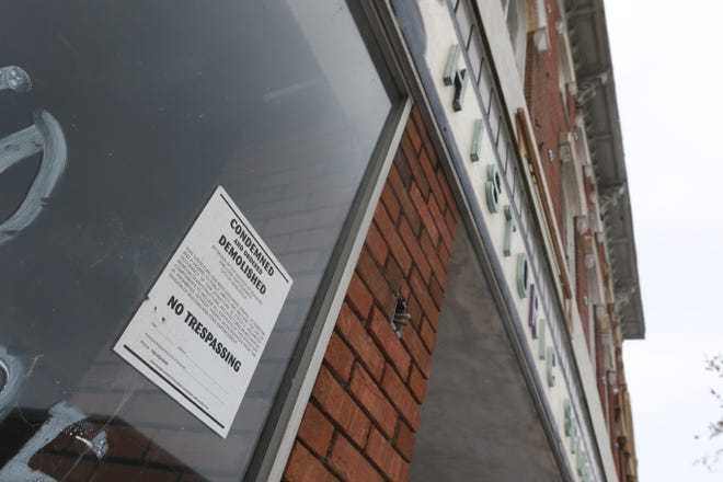 A condemnation notice hangs on the window of 608 Main Street. The building's owner, Nate Embrey, said 2021 will be a big year for the property.