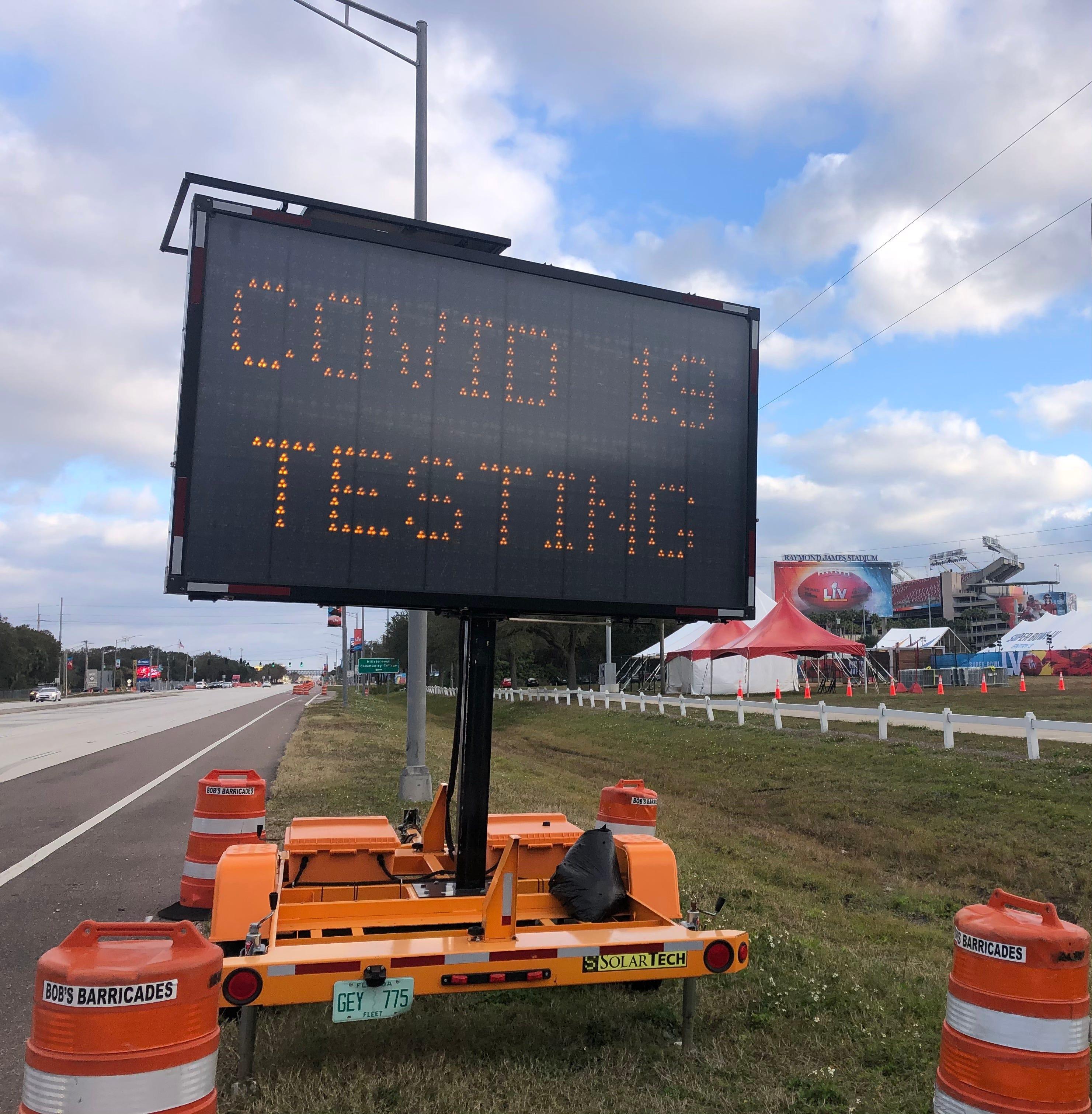 COVID-19 testing sign near Raymond James Stadium.