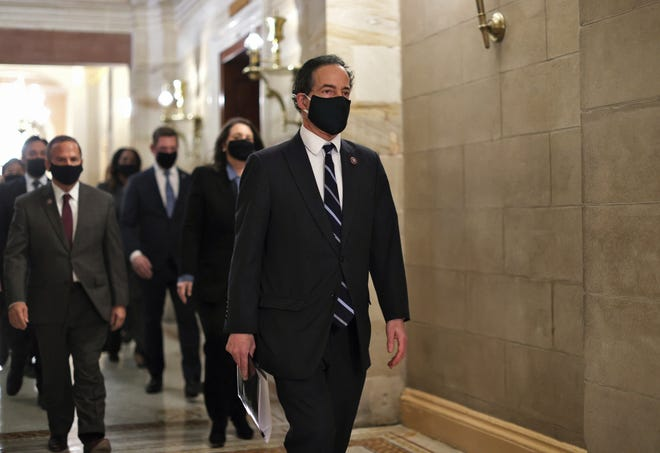 Lead House impeachment manager Rep. Jamie Raskin, D-Md., and other Democratic managers walk through the Capitol to deliver to the Senate the article of impeachment alleging incitement of insurrection against former President Donald Trump on Jan. 25.