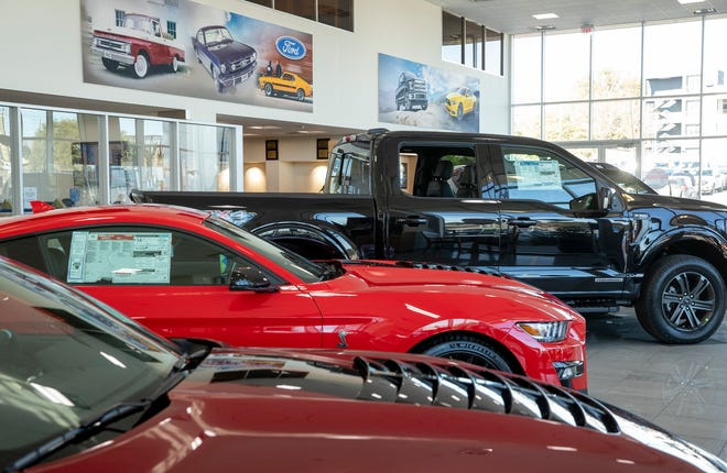 New cars await potential buyers in the showroom at Maxwell Ford in Austin on Feb. 2.  Sales in Central Texas are showing signs of recovering from the coronavirus plunge, according to the most recent industry data.