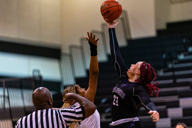 Cedar Ridge forward Lexi Alexander wins the tip against the Vandegrift in a District 25-6A contest Feb. 2 at Vandegrift High School.  The Raiders rallied for a 36-26 win.