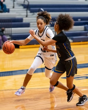 Zoe Nelson drives for Hendrickson against Pflugerville's Avari Berry. Nelson recorded a triple-double as Hendrickson won a district girls basketball game against Pflugerville at home 60-48 on Feb. 2