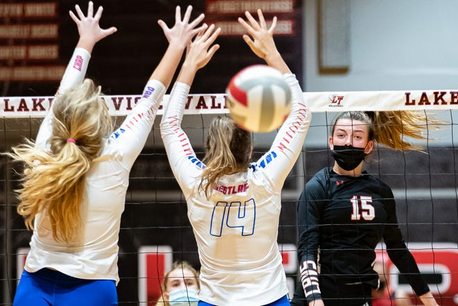 Lake Travis outside hitter Jamison Wheeler, watching a kill split a pair of Westlake defenders in October, earned the American-Statesman Player of the Year honor after helping the Cavaliers to a perfect regular season,