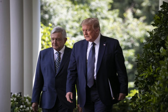 Former U.S. President Donald Trump and Andres Manuel Lopez Obrador, Mexico's president, arrive to a signing ceremony at the White House on July 8, 2020. [Al Drago/Sipa USA/TNS]